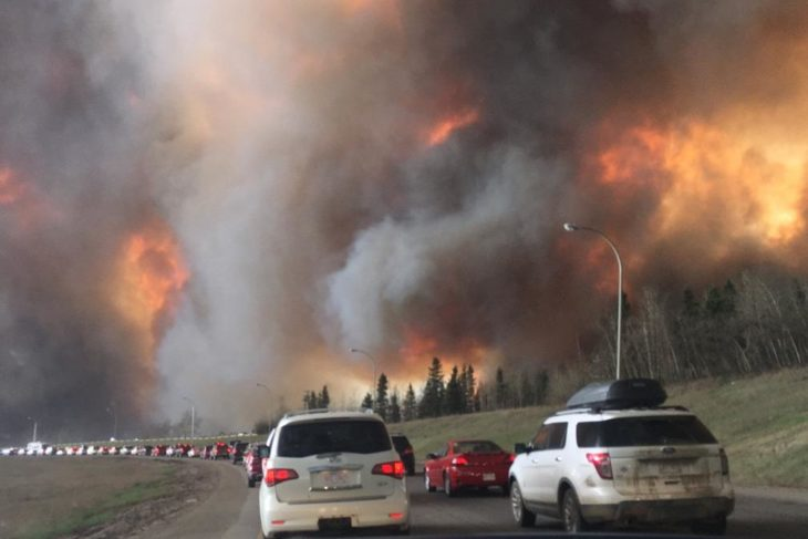 Citizens depart Fort McMurray amidst the wildfires in May, 2016 (Photo courtesy DarrenRD)
