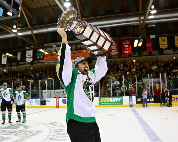 Cole Fonstad lifts the Ed Chynoweth Cup moments after the Prince Albert Raiders won the WHL championship, in a Game 7 OT victory.