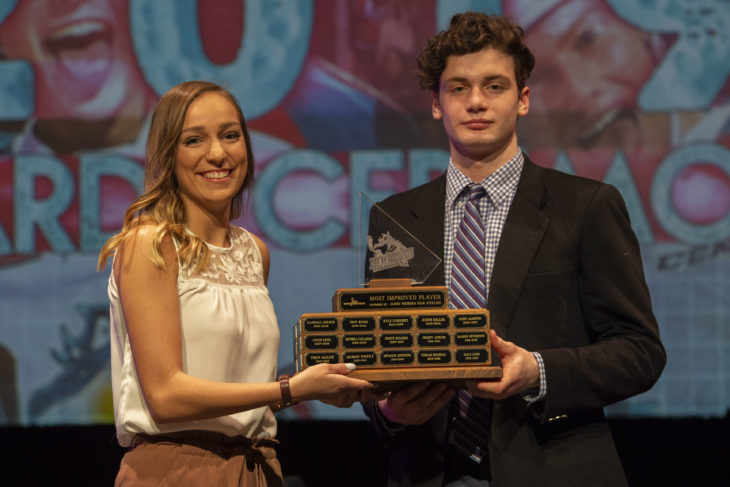 KELOWNA, BC - MARCH 17: Allie Siegmann of Western Star R James Management Group presents Mark Liwiski #9 of the Kelowna Rockets with the Most Improved Player award at the annual Kelowna Rockets awards ceremony at Kelowna Community Theatre on March 17, 2019 in Kelowna, Canada. (Photo by Marissa Baecker/Shoot the Breeze)