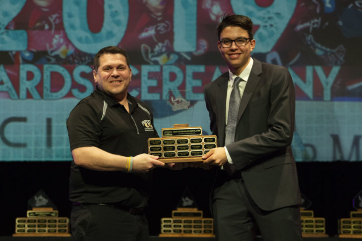 KELOWNA, BC - MARCH 17: Jeff MacIsaac of Popeye Supplements presents Devin Steffler #4 of the Kelowna Rockets with the Most Sportsmanlike award at the annual Kelowna Rockets awards ceremony at Kelowna Community Theatre on March 17, 2019 in Kelowna, Canada. (Photo by Marissa Baecker/Shoot the Breeze)