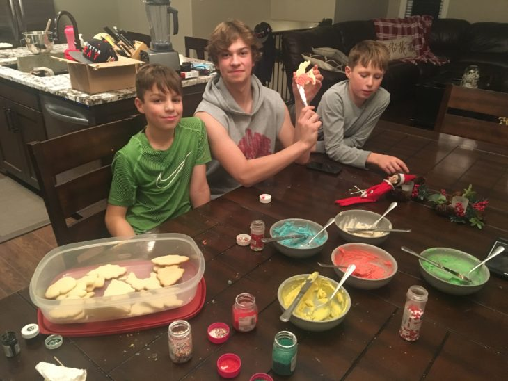 Chase decorating sugar cookies with billet brothers, Jake and Owen.