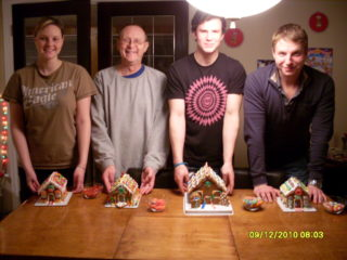 Alisha, Kevin, Brandon Anderson, and Kurt building gingerbread houses
