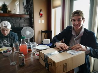 Dylan opening his Christmas gift after his return from World Juniors