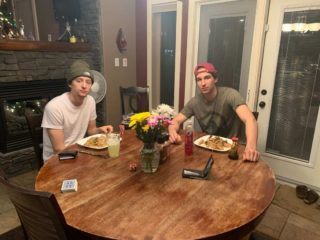 Alex and Dylan eating dinner