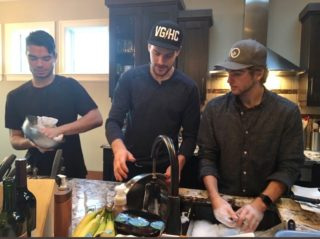 Brady Pouteau, Stuart Skinner, and Brendan Stafford doing dishes after Thanksgiving dinner