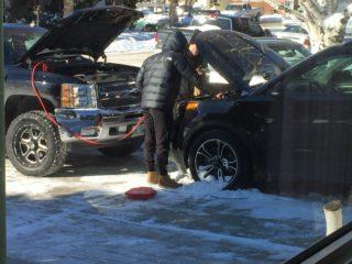 Nick and Jake boosting Jake's car