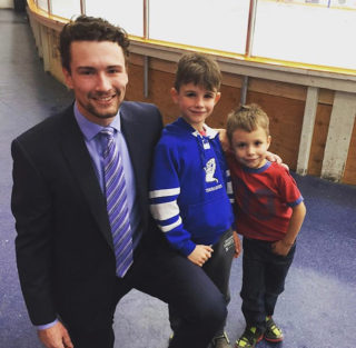 Ryon Moser with Macai and Lachlan at UofL/UBC Game
