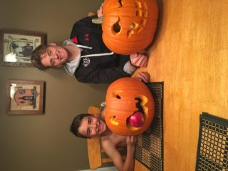 Spencer and Logan carving pumpkins