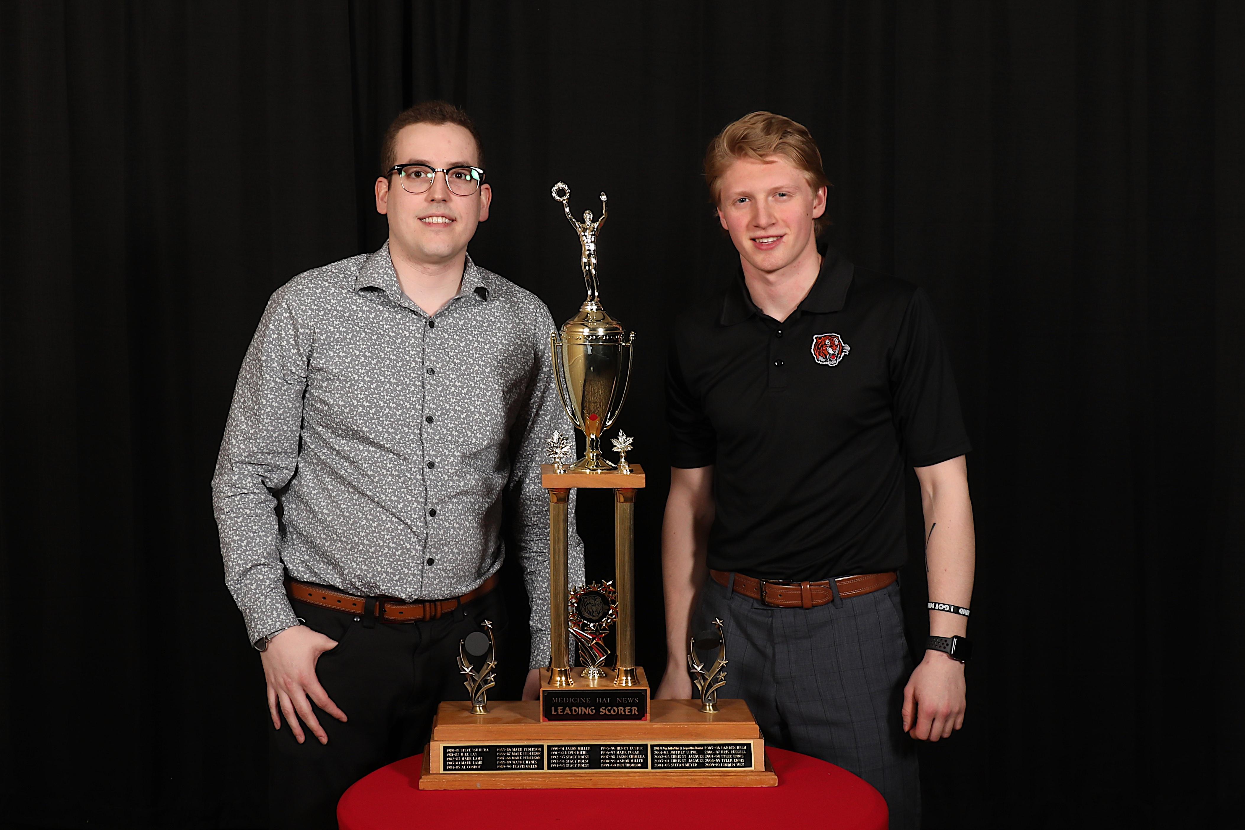 Ryan McCracken of the Medicine Hat News presents the Medicine Hat News Leading Scorer Award to James Hamblin