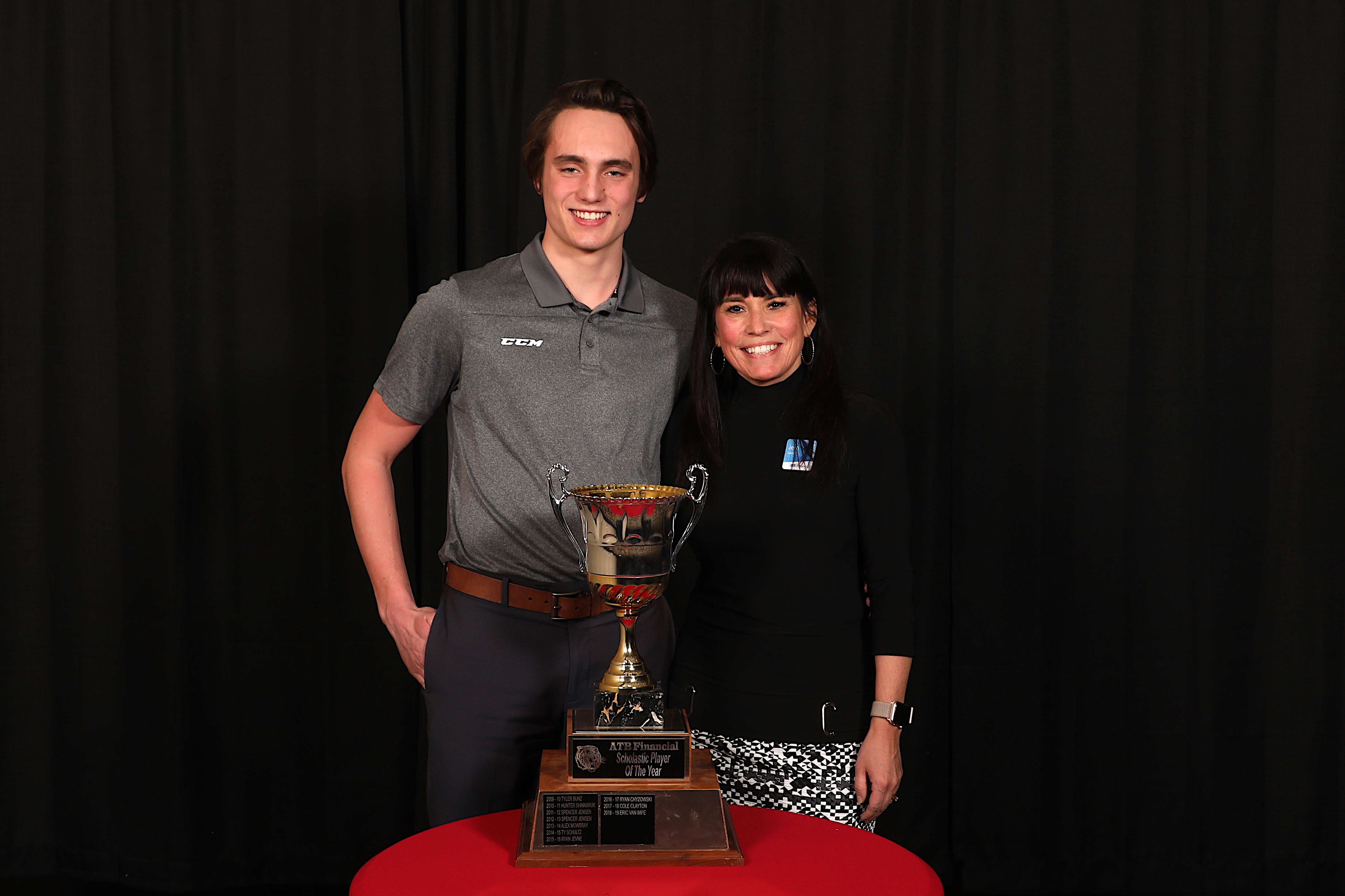 Jerri Gainer, Branch Manager at ATB Financial presented the ATB Financial Scholastic Player of the Year Award to Eric Van Impe