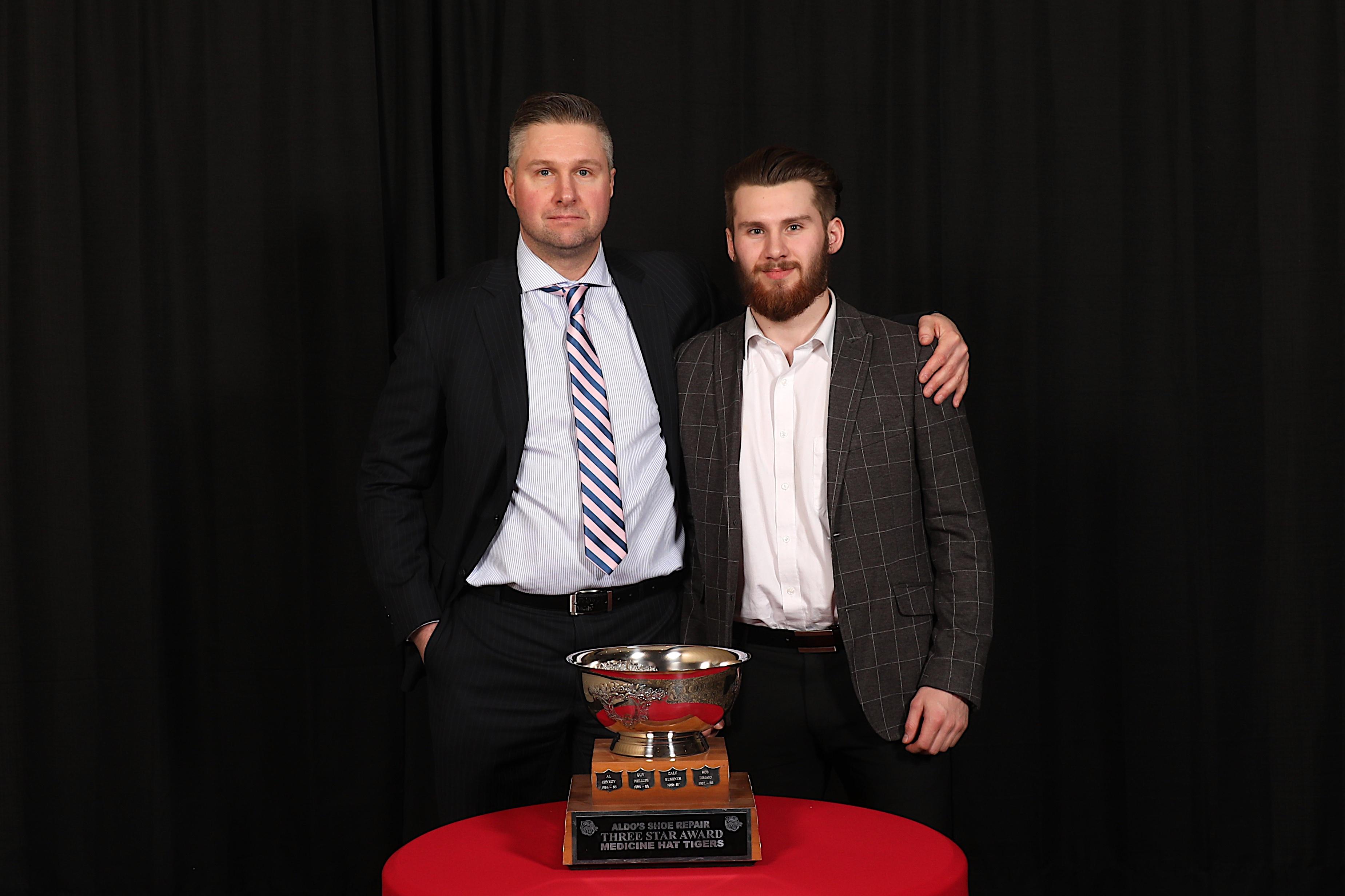 AC Ryan Smith presented Ryan Jevne with the Aldo's Shoe Repair 3 Star Award