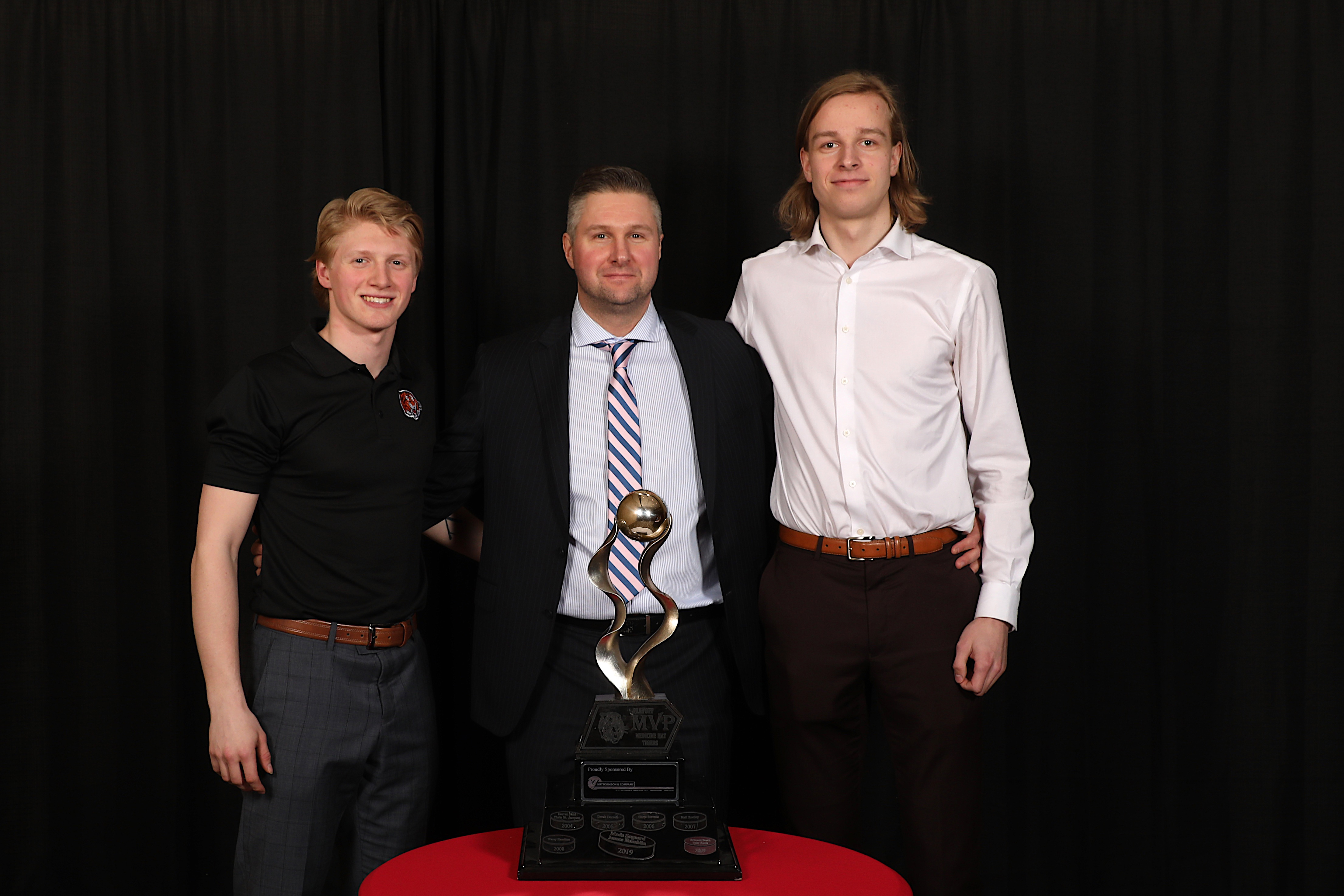 AC Ryan Smith presented the Guttormson & Co. Chartered Accountants Playoff MVP to Mads Søgaard & James Hamblin