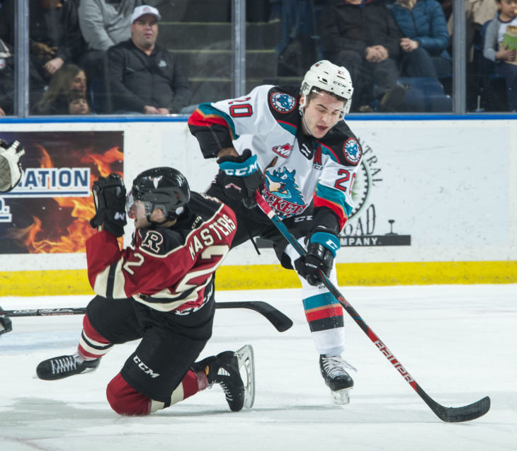 KELOWNA, BC - FEBRUARY 15:  Kyle Masters #2 of the Red Deer Rebels collides with Matthew Wedman #20 of the Kelowna Rockets during first period at Prospera Place on February 15, 2020 in Kelowna, Canada. (Photo by Marissa Baecker/Shoot the Breeze)