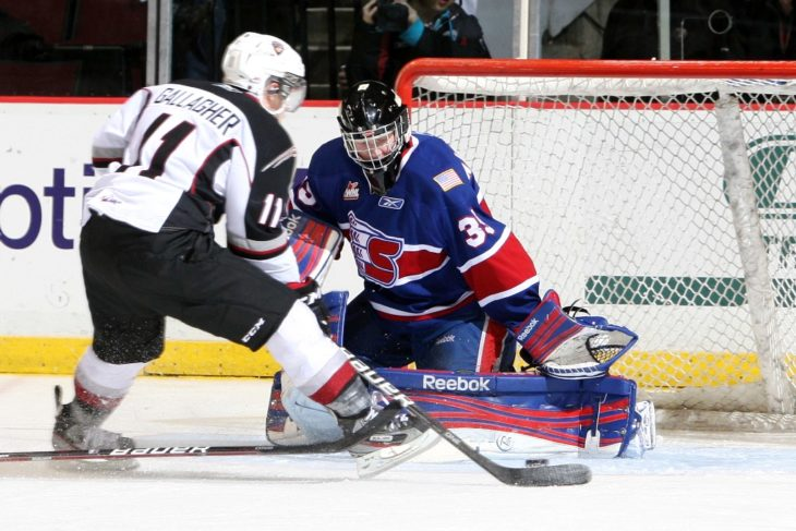 Brendan Gallagher shooting on Eric Williams in Game 2 of Spokane Chiefs vs. Vancouver Giants in the first round of WHL Playoffs.